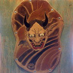 """Hannya"", leather on reclaimed plywood. (c)Michael King."