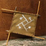 """Noita"", burlap, arrows, string, and paint. (c)Autumn Doyle."
